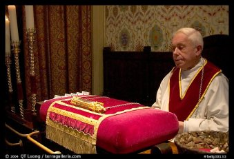 Priest and relic of Christ's blood. Bruges, Belgium